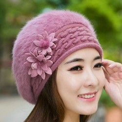 Knitted beret - a warm fur hat with decorative flowers